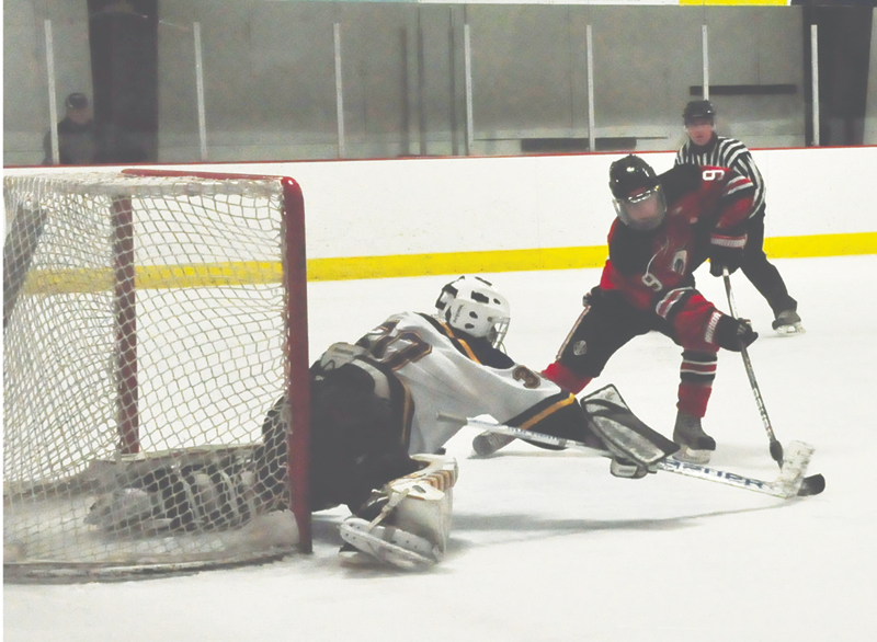 AC Goalie John Richard thwarts this scoring attempt by Reading's  James Donaghey, but the Rockets prevailed, 3-1