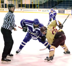 Cathedral's Peter Crinella (#3) takes the faceoff against BC High's Justin Vein (#26)