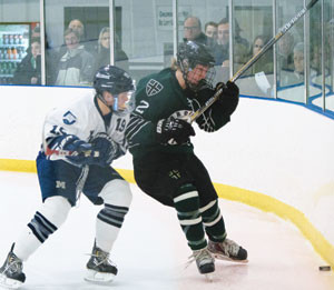 BROOKS FORWARD Henry Cormier is checked by Millbrook's Jacob Moreau during 4-1 Brooks win. (Photo by Jamie Callery)