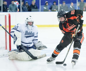 KIMBALL UNION's Pat Shea tries to control puck in front of Nobles goaltender Harry Sherman. (Jamie Callery photo)