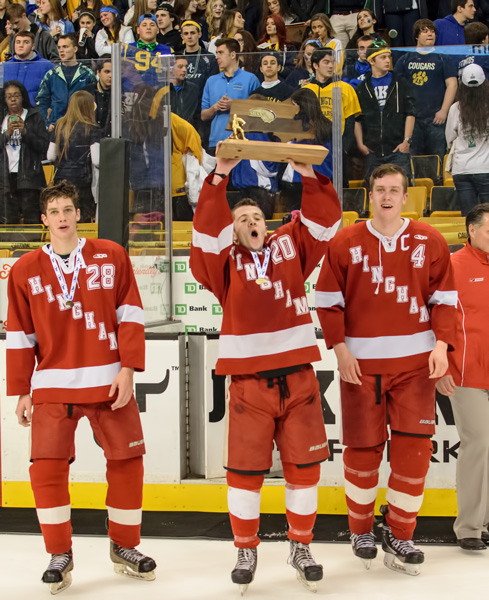 HINGHAM CAPTAINS (l to r) Jack Forbes, Dan Shea and Mike Saleski show the Hingham faithful the MIAA Division I championship trophy.  (Photo by Jamie Callery)